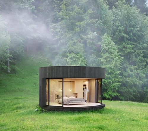Studio Lumicene navrhlo minimalistickou ovální chatku v přírodě