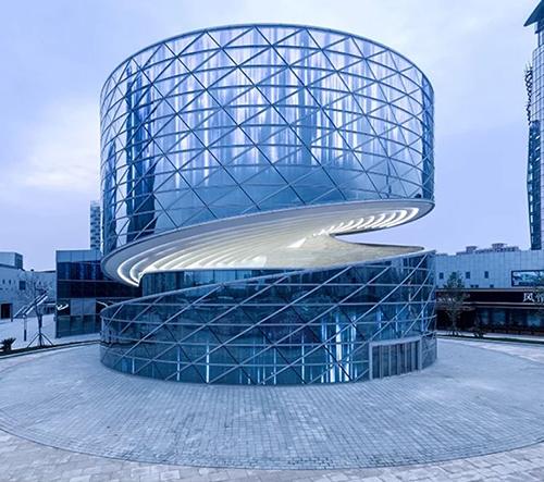 ATAH studio navrhlo pro Čínské textilní centrum neuvěřitelnou spirálovitou budovu
