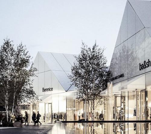 Luxusní vesnice nebo nákupní centrum? Francouzi lákají prémiovou klientelu