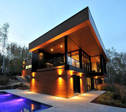 Studio Espace Vital navrhlo v kanadském Québecu majestátní dřevěnou vilu