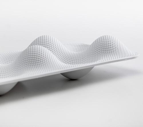 Eggwave je designový stojan na vajíčka od studia WertelOberfell