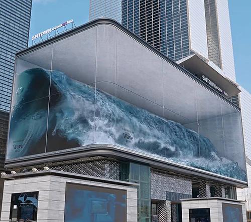 Wave je anamorfická iluze vlnobití v proskleném kvádru